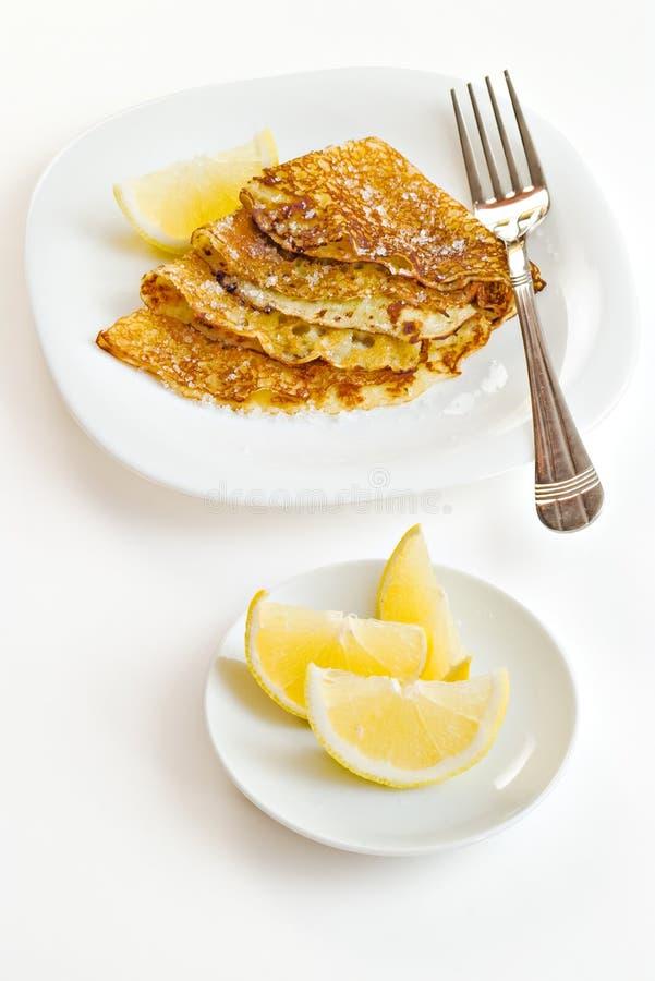 Pancakes with lemon slices stock photos