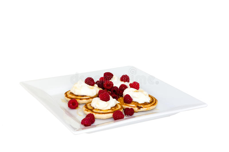 Pancakes with mascarpone and raspberries stock images