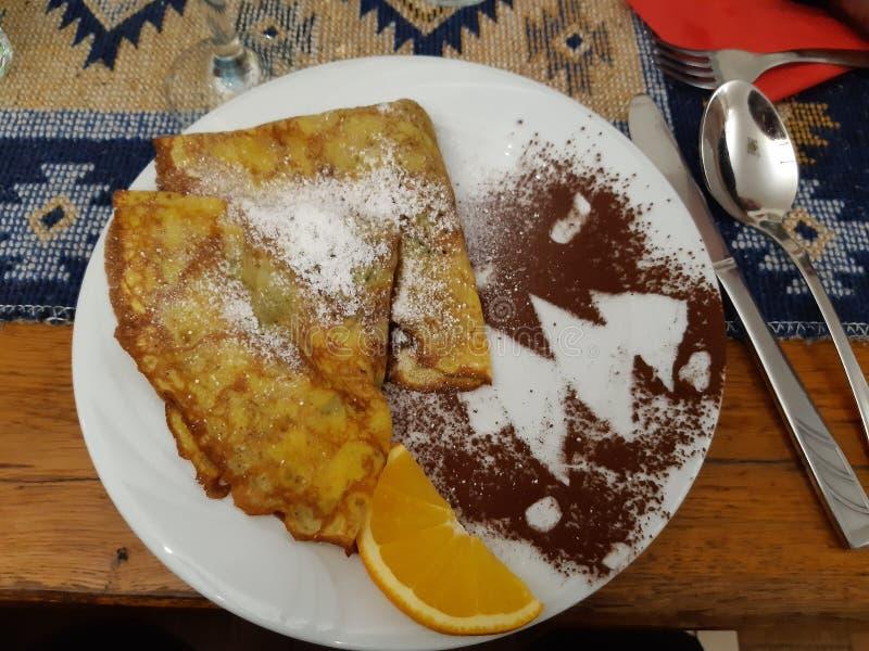 Pancakes med skinka arkivbild