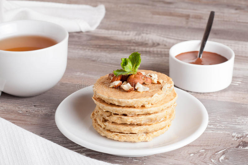 Pancakes with nuts, decorated mint for breakfast, horizontal stock photo