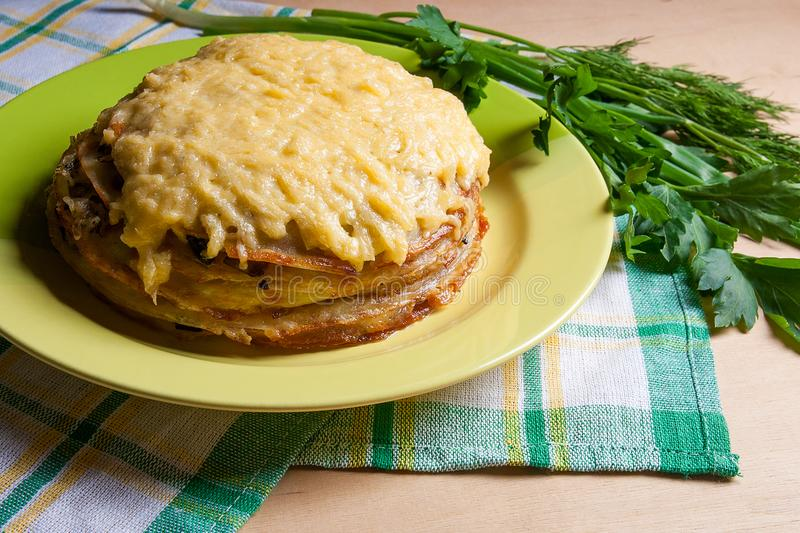 Pancake pie with mushrooms and chicken meat baked with cheese on green plate. Pancake cake on green plate with herbs dill green onion parsley around the ... & Pancakes Pie With Mushrooms And Chicken Meat. Traditional Meal F ...