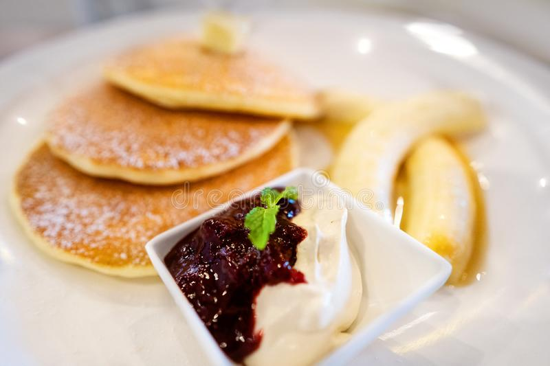 Pancakes on a plate of fruit royalty free stock photo