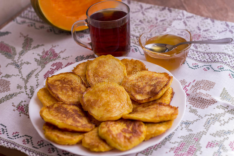 Pancakes with pumpkin in bowl on Halloween stock photos