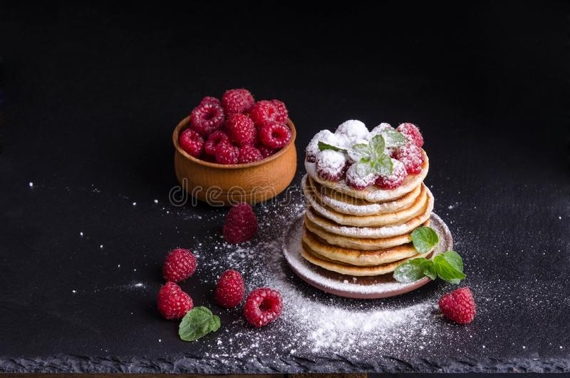 Pancakes with raspberries and berries around royalty free stock photos