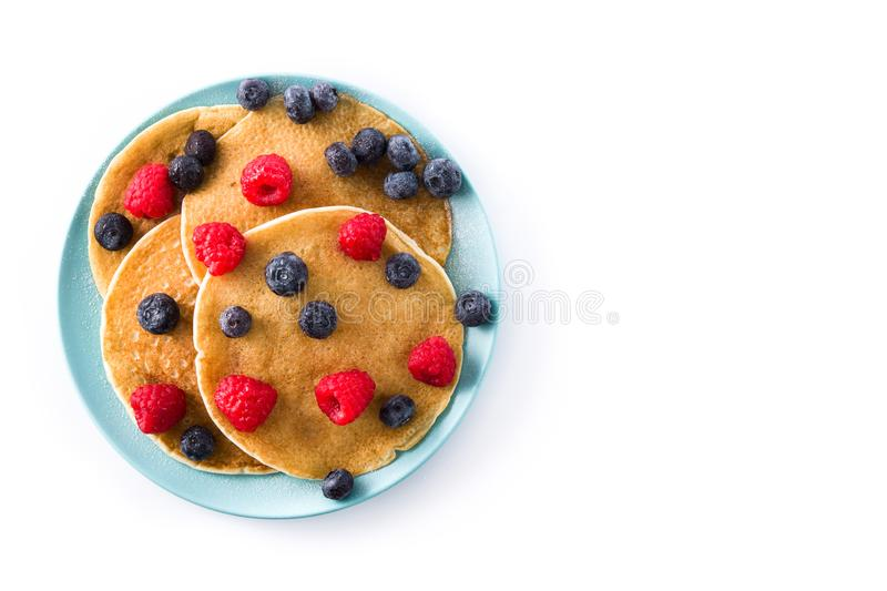 Pancakes with raspberries and blueberries isolated. On white background. Top view. Copyspace royalty free stock photo