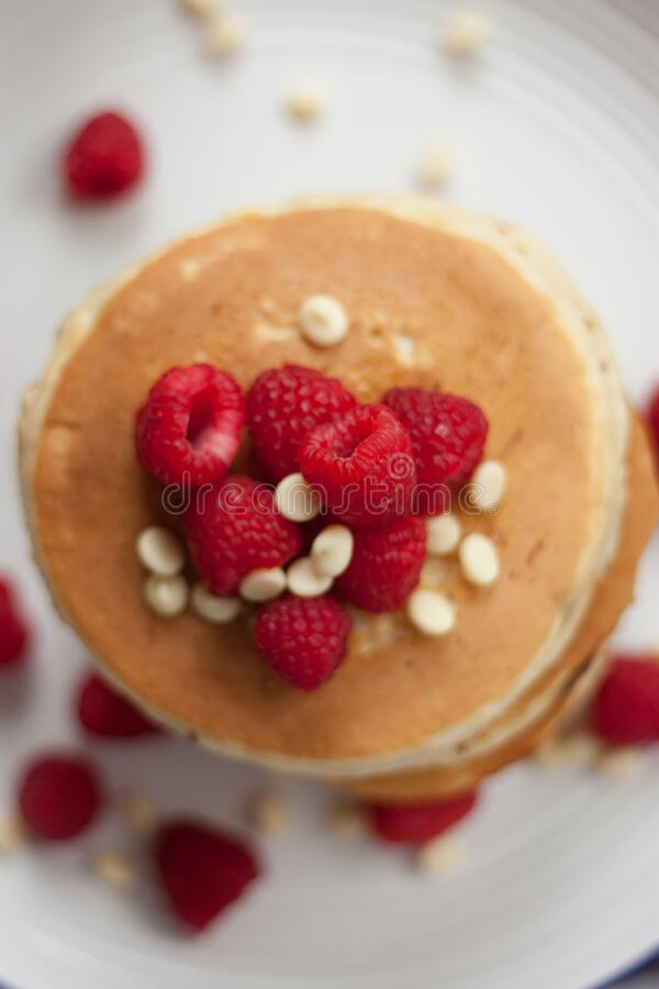 Pancakes and raspberries royalty free stock photos