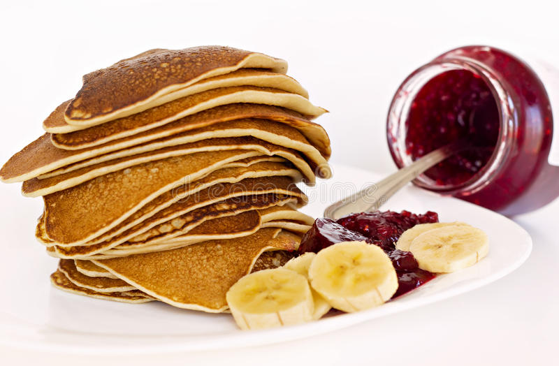 Pancakes with raspberry jam stock photo