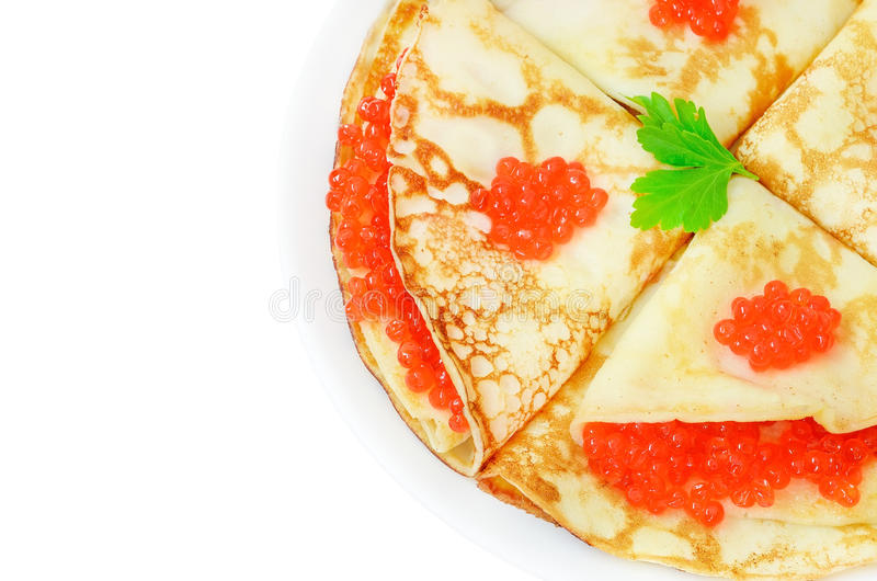 Pancakes with red caviar on a plate. Isolated on white background stock photo