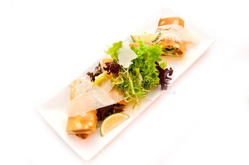 Pancakes with red fish cheese and herbs on a dish.  stock photos