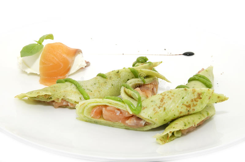 Pancakes with red fish stock image