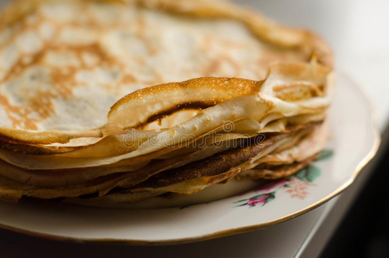 Pancakes or Russian Blintzes on white background. Selective focus royalty free stock image