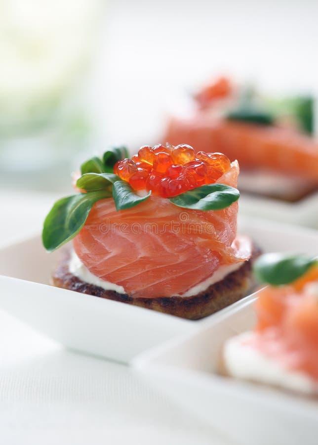 Pancakes with salmon and caviar royalty free stock image