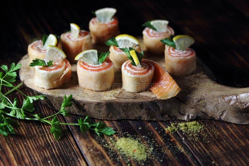 Pancakes with salmon,lemon stock image