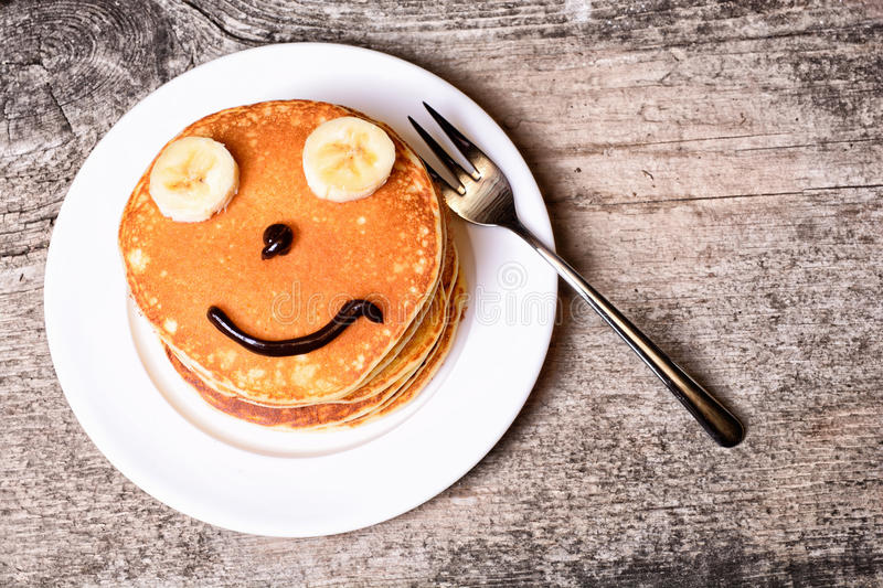 Pancakes with smile royalty free stock image