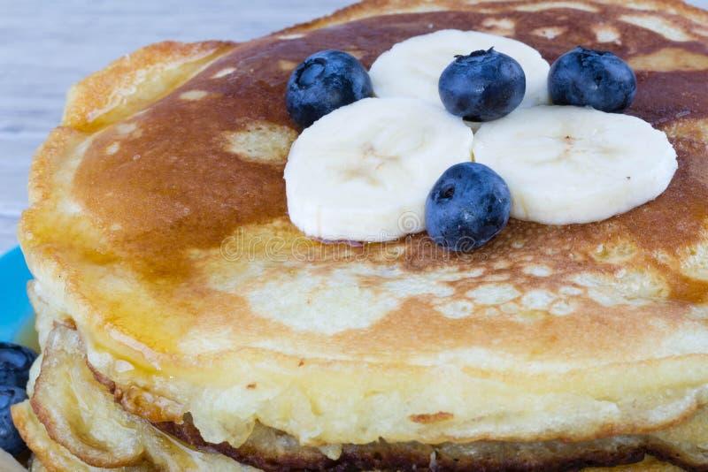 Pancakes. Stack of pancakes and fresh fruits stock photos