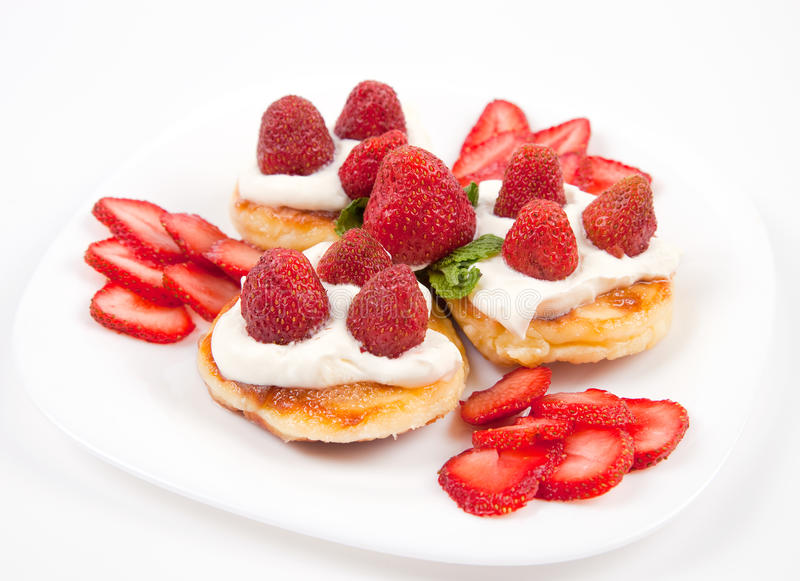 Pancakes with strawberries and cream stock images