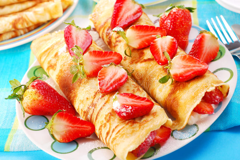 Pancakes with strawberry stock image