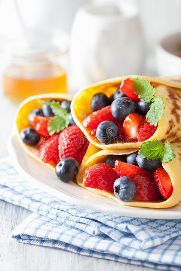 Pancakes with strawberry blueberry royalty free stock photography