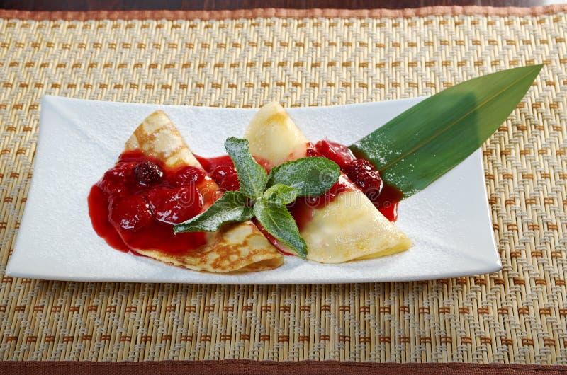 Pancakes with strawberry jam. Closeup royalty free stock photo
