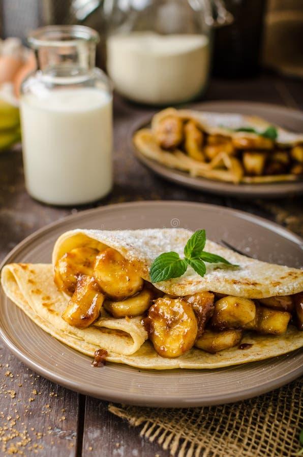 Pancakes stuffed with bananas royalty free stock photos