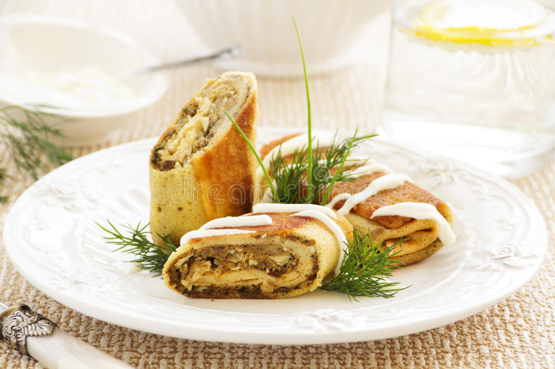 Pancakes stuffed with liver stock image