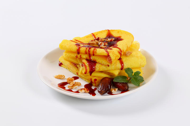 Download Pancakes With Walnuts, Dates And Chocolate Topping Stock Image - Image: 83706941
