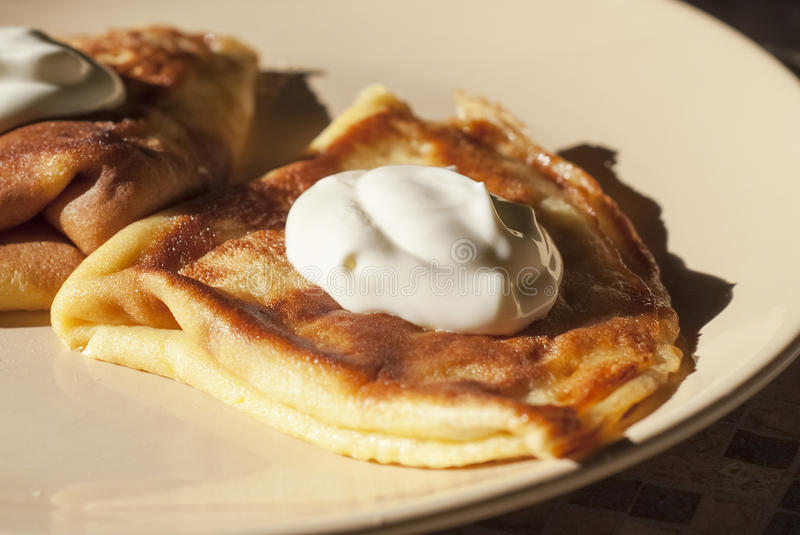 Pancakes with white cheese and sour cream royalty free stock photo