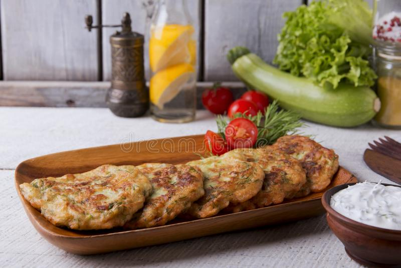 Pancakes zucchini fritters vegetarian yogurt sauce. A stock image