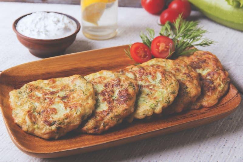Pancakes zucchini fritters vegetarian yogurt sauce. A royalty free stock image