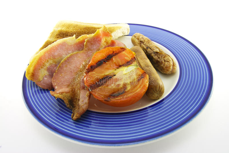 Pancetta affumicata e salsiccia con pane tostato fotografia stock libera da diritti