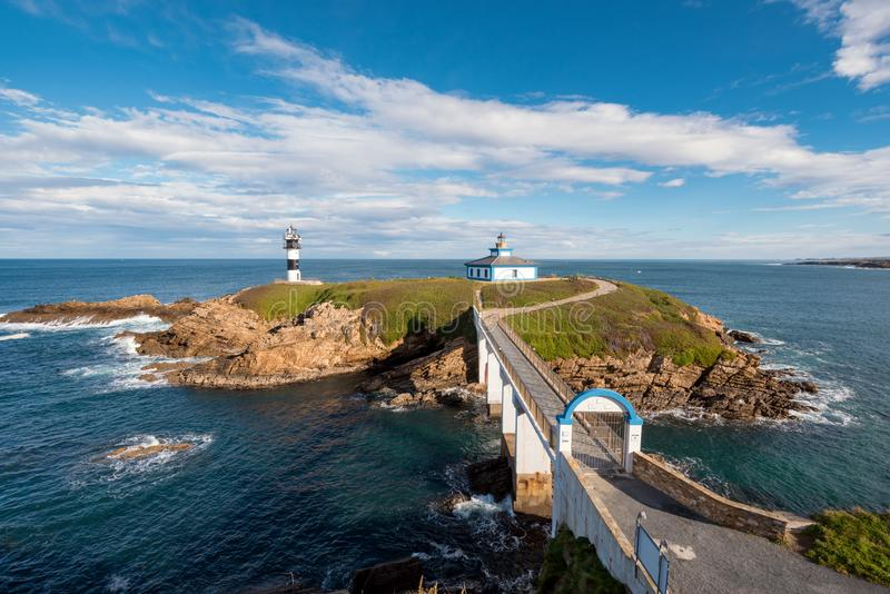 Pancha island lighthouse in Ribadeo coastline, Galicia, Spain.  stock photos