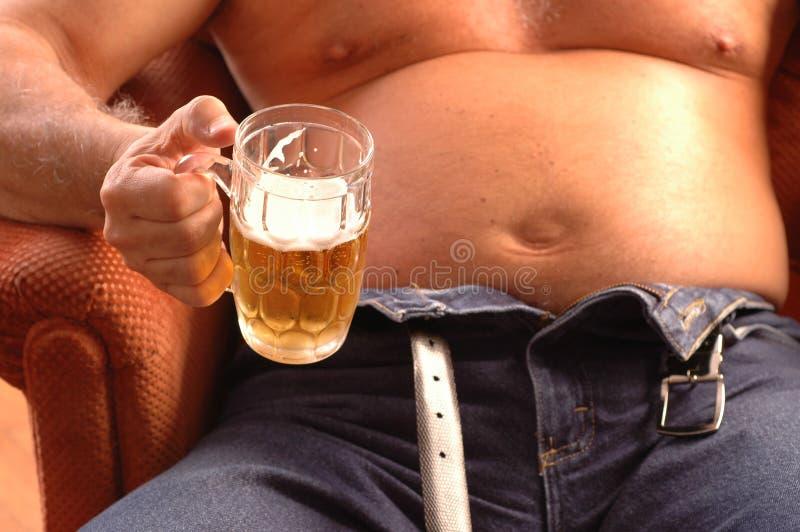 Pancia di birra immagine stock
