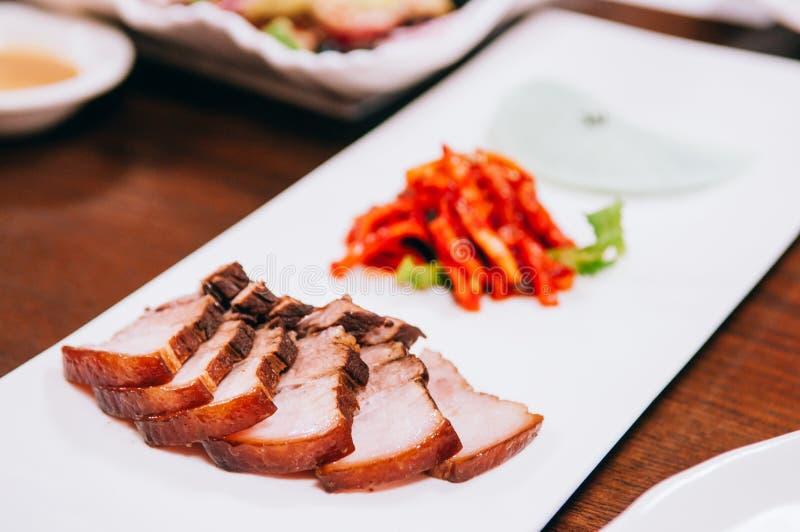 Pancia di carne di maiale di Samgyupsal con il piatto coreano del barbecue di Kimchi fotografia stock