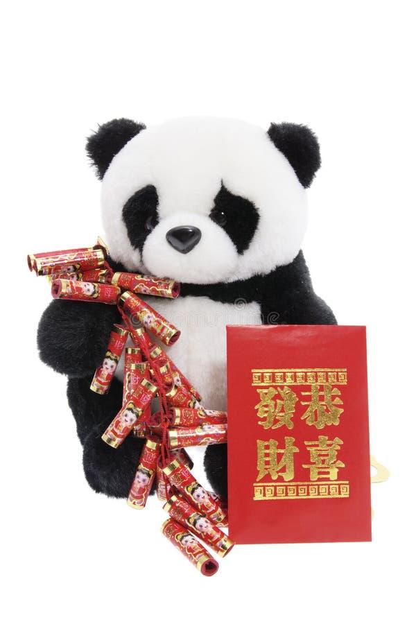 Panda do brinquedo com as decorações chinesas do ano novo foto de stock