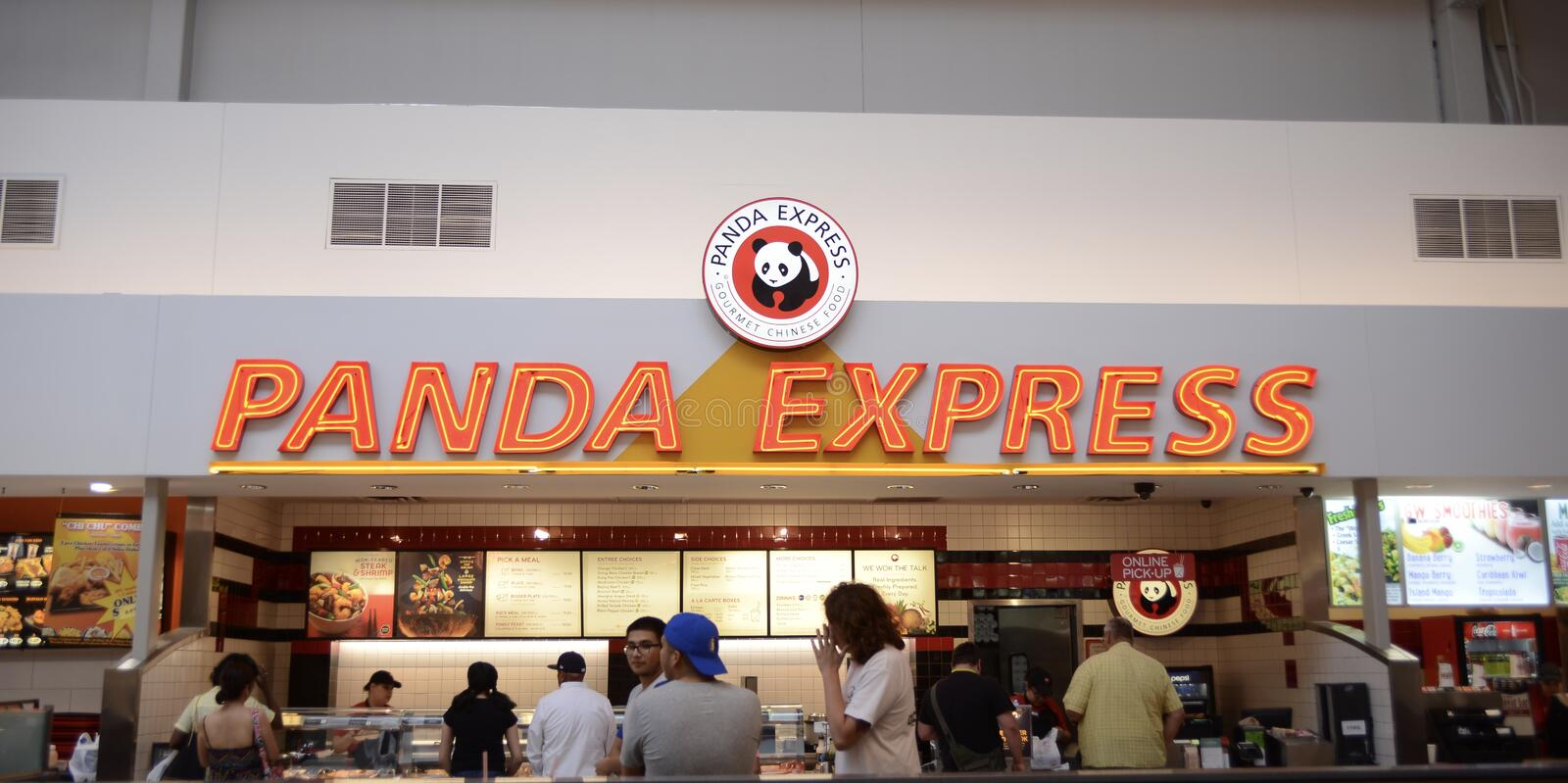 Panda Express Restuarant in a Mall Food Court. The Panda Express menu includes a variety of entrees with Chinese and Sichuan influences. All are wok-cooked stock photography