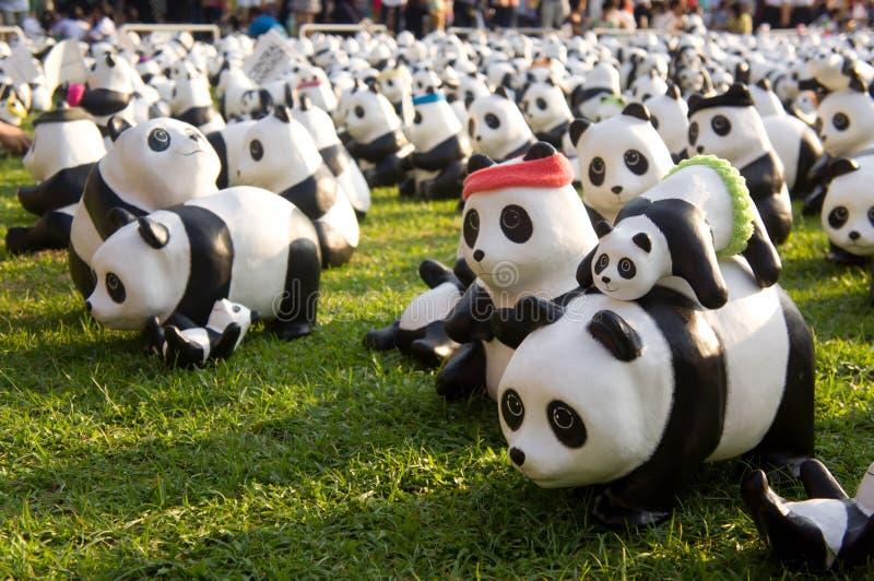 Panda flashmob an Lumpini-Park lizenzfreie stockfotografie