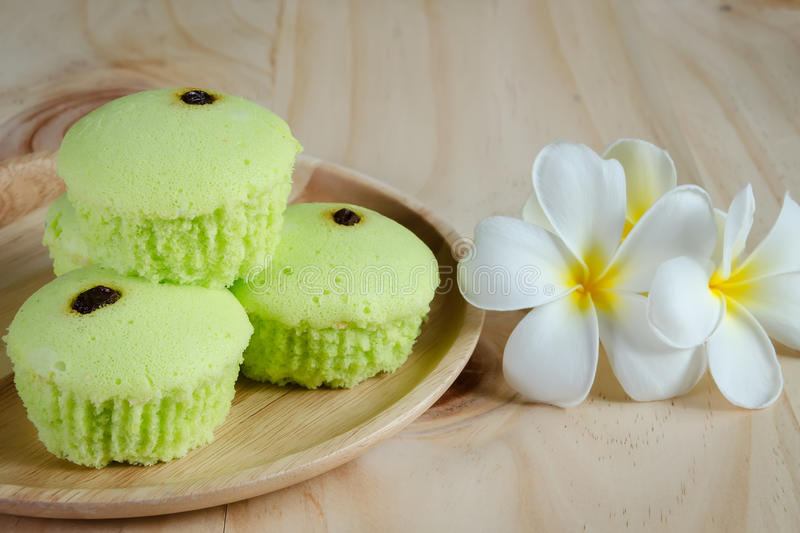 Pandan cake on wood table. Cake from pandan leaf on wood table royalty free stock image