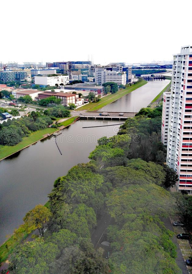 Pandan River, Singapore. Hdb, flats, residential, district, industrial, housing, full, plain, clear, broaf, broad, wide, long, straight, cansl, canal, channel royalty free stock images