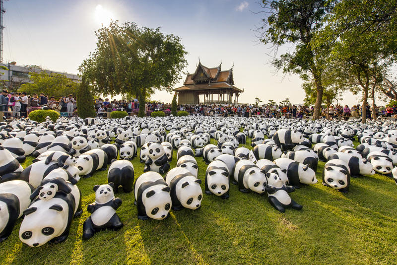 1600 Pandas. BANGKOK,THAILAND-MAR 12:1600 Pandas World Tour by WWF at Santi Chai Prakan Park on March 12, 2016. These paper marche pandas are made from recycled royalty free stock photo