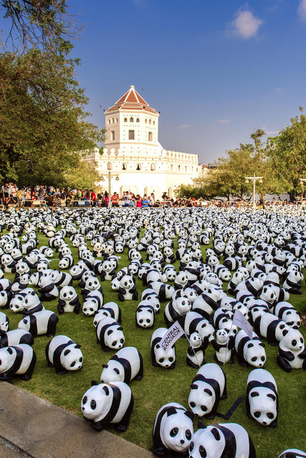 1600 Pandas. BANGKOK,THAILAND-MAR 12:1600 Pandas World Tour by WWF at Santi Chai Prakan Park on March 12, 2016. These paper marche pandas are made from recycled royalty free stock photography