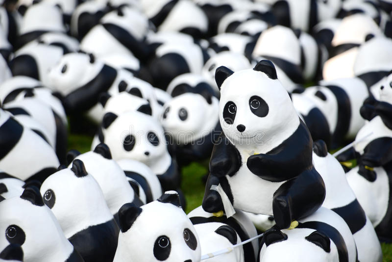1600 Pandas. BANGKOK,THAILAND-MAR 12:1600 Pandas World Tour by WWF at Santi Chai Prakan Park on March 12, 2016. These paper marche pandas are made from recycled royalty free stock images