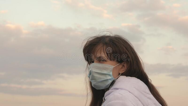 Pandemic Coronavirus. free woman tourist wearing a protective mask on street. Protection against viruses and bacteria. Pandemic Coronavirus. free woman tourist royalty free stock photos
