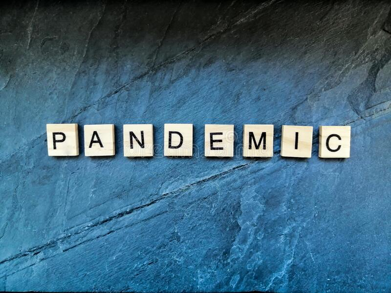 Pandemisk text med blå bakgrund fotografering för bildbyråer