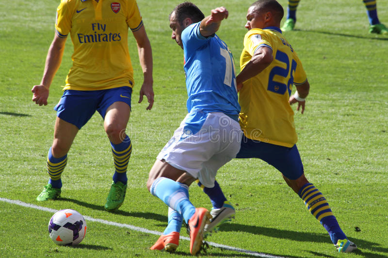 Pandev in Arsenal-Napoli. Image of Goran Pandev (Napoli, in blue) during the match Arsenal-Napoli for the Emirates Cup 2013, played in London on the 3rd of stock photos