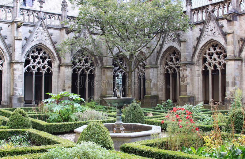 The Pandhof garden of Dom Church, Utrecht, Holland. The Pandhof garden of the Dutch Utrecht Dom Church, a monastery garden with medieval style elements where royalty free stock photo