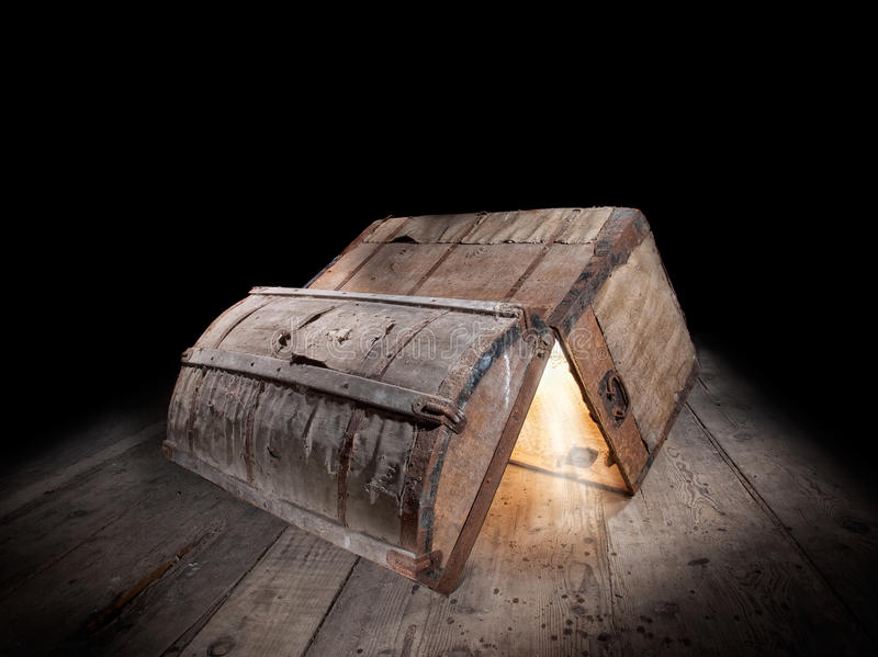 Pandora box. Upturned and opened an old wooden box with glowing light from inside royalty free stock image