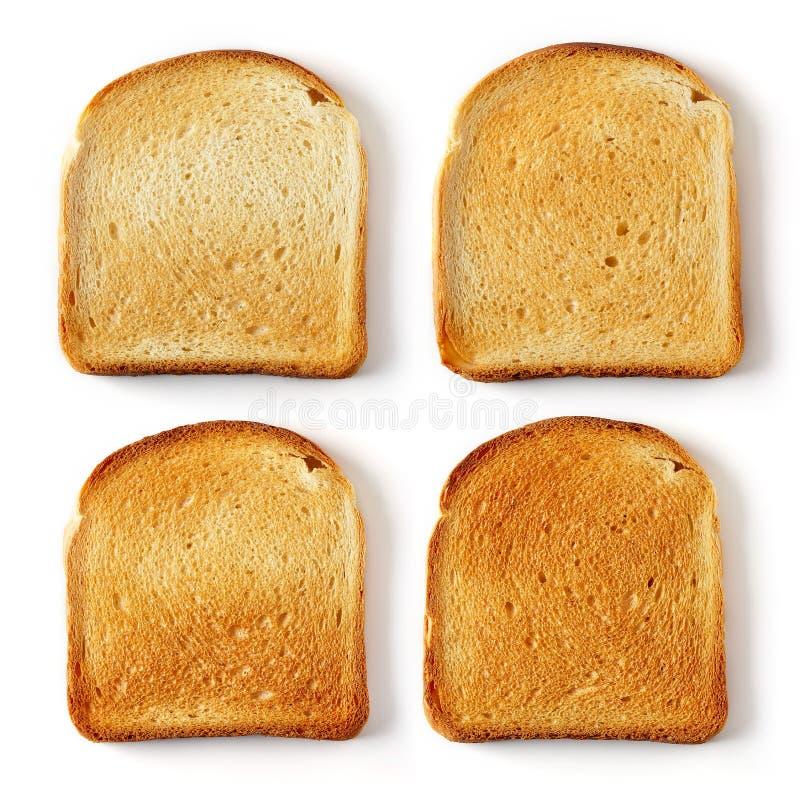 Pane affettato del pane tostato isolato su bianco fotografia stock