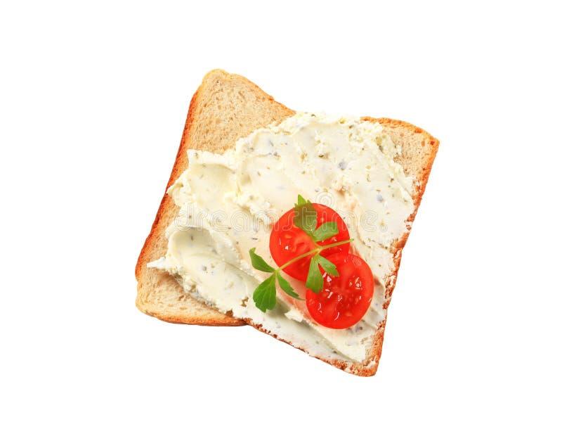 Pane bianco con la diffusione di formaggio fotografia stock libera da diritti