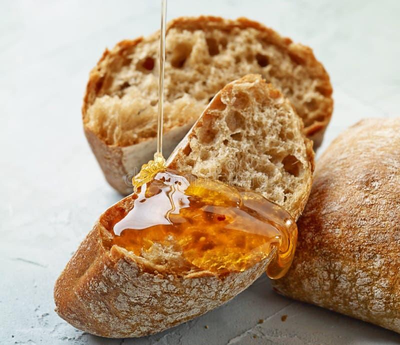 Pane con miele fotografia stock