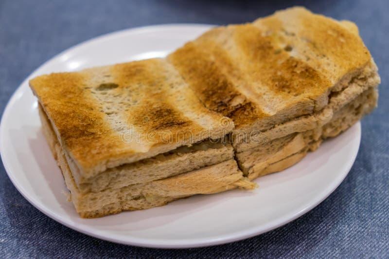 Pane della prima colazione Kaya Toast, del caffè di Singapore e mezzo uovo sodo fotografia stock libera da diritti
